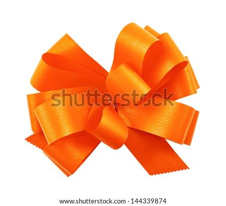 Gift ribbon orange glossy bow isolated over white background