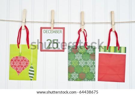 Gift Sack and Christmas Calendar Page on a Clothesline.  Holiday Concept.