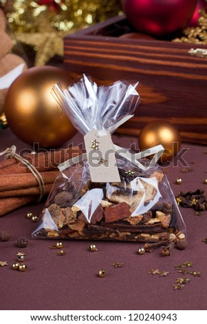 Gift set of various spices with red and golden christmas baubles