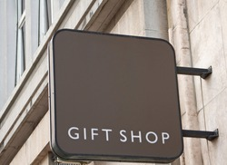 Gift shop sign on wall of traditional building