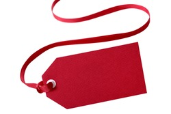 Gift tag with red ribbon isolated on white.