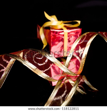 gift with ornamental tape on a black background
