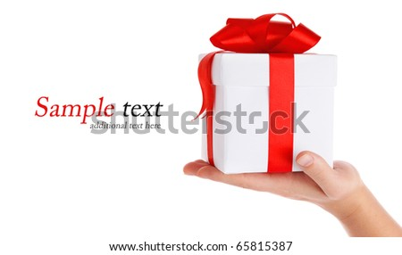 gift with red bow in hand isolated on white background