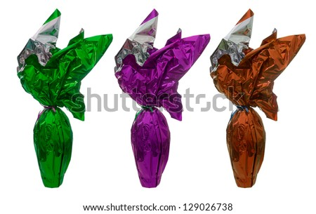 Gift wrapped chocolate Easter eggs isolated over white background