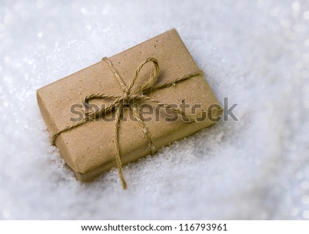 Gift wrapped in paper in the snow