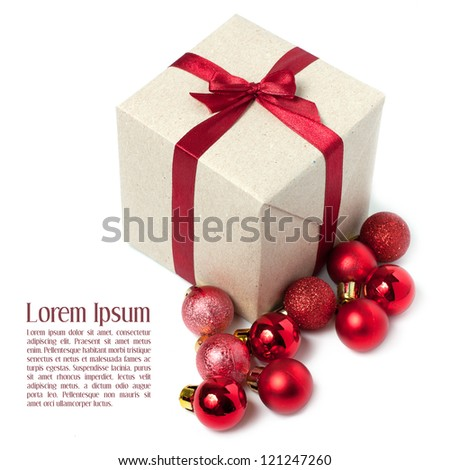 Gift wrapped red ribbon with bow, isolated on white, Christmas box and balls