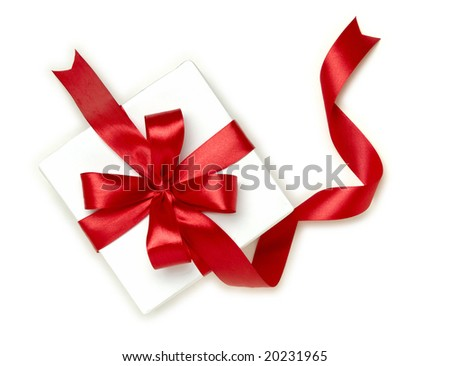 gift wrapped with a red ribbon on a white background
