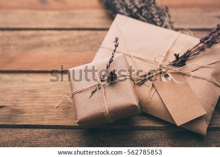 Gift wrapping composition. homemade wrapped  present boxes, decoration and tools on wooden background. above view, flat lay #562785853