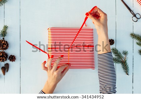 Gift wrapping. Woman packs gifts, step by step
