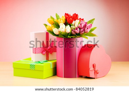 Giftbox and tulips against gradient background - stock photo