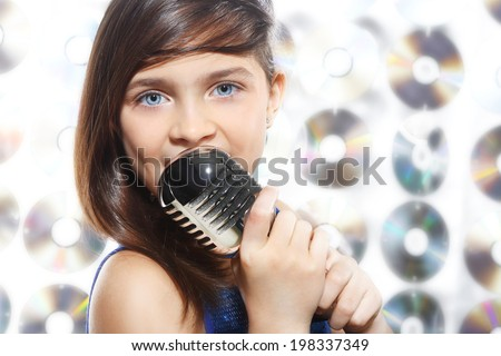 Gifted child. Child, teen, girl, singing into a microphone, a small singer