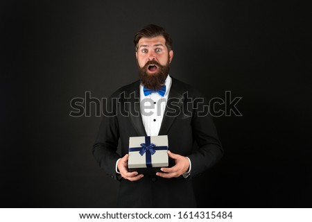 Gifting surprise for all. Surprised man with open mouth. Businessman got surprise. Hipster hold surprise box. Surprise from boss for employees. Present and souvenir. Gift shop.