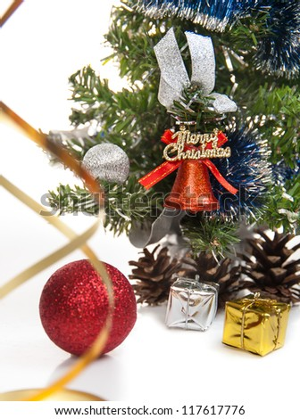 gifts,cones,Christmas ball,serpentine,dressed up fur-tree on the white