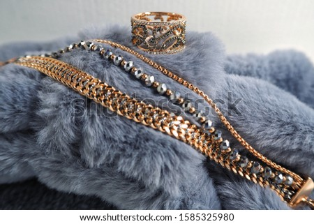 gifts for a beloved woman or mother, for a holiday or anniversary, gold jewelry, rings and bracelets in macro mode for the new year or Valentine's Day