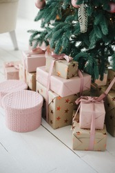gifts in a pink powder packaging near the Christmas tree