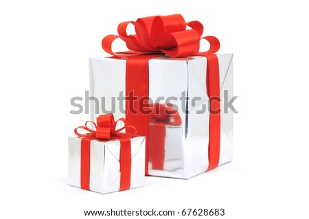 Gifts in silver wrapping with red bow isolated on white background
