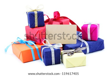 Gifts pack with a blank card isolated on a white background. - stock photo