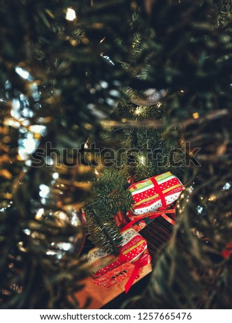 Gifts under the Christmas tree, Happy New Year, Christmas background with gift boxes under the fir with crystal led lights and balls. #1257665476