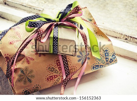 gifts with packaging paper and atlas bows/vintage holiday background