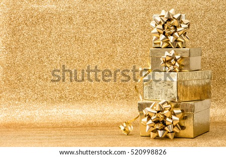 Gifts with ribbon bow on golden background. Holidays decoration. Christmas Birthday Valentines Day