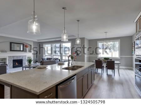 Gig Harbor, WA / USA - Feb. 24, 2019: Luxury kitchen, living room, and dining room interior #1324505798