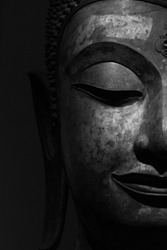Gigantic Buddha's idol face in black and white