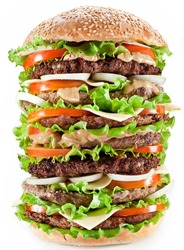 Gigantic hamburger on white background. Fast food concept.