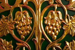 gilded bas-relief of grapes, ornate old furniture