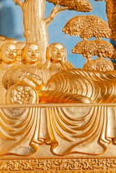 Gilded bronze gold Buddha sculpture of the Peace Pagoda in Battersea Park London England  which is a popular travel destination tourist attraction landmark of the city, stock photo image