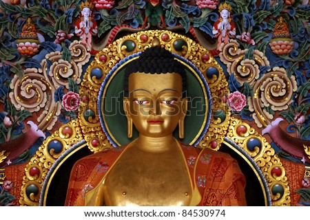 gilded metal statue of preaching Buddha in a Tibetan Buddhist monastery in , Chandragiri, Orissa,India