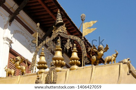 Gilded ornamention atop Golden Gate (Sun Dhoka) into 55 Window Palace in Durbar Square, Bhaktapur, Kathmandu Valley, Nepal #1406427059