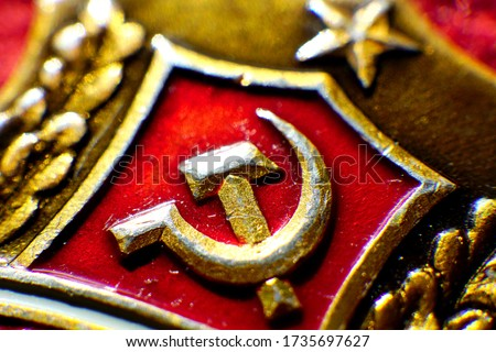 Gilded symbol of communism on a red background. Сток-фото ©