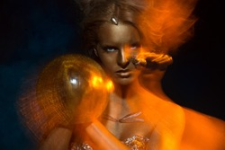 Gilt. Golden Plated Woman's Face. Art concept. Gilded Body. Focus on her hands