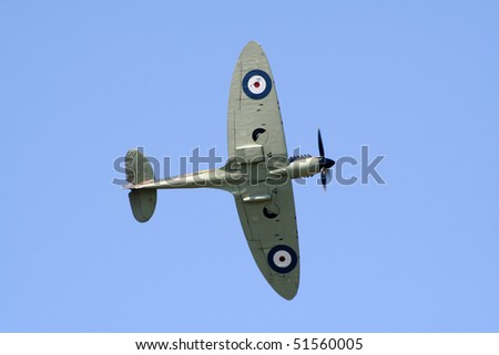 GILZE-RIJEN, THE NETHERLANDS - JUNE 18: Royal Air Force Memorial Flight Supermarine Spitfire flyby on the Dutch Air Force Open Days. June 18, 2005 in Gilze-Rijen, The Netherlands