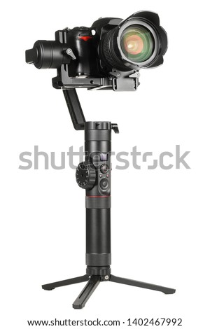 Gimbal three-axis motorized stabilizer with mounted DSLR camera isolated on white background #1402467992