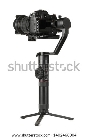 Gimbal three-axis motorized stabilizer with mounted DSLR camera isolated on white background #1402468004