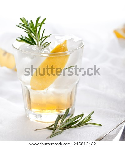 Gin,lemon, rosemary fizz, cocktail with honey and fresh herbs on a white background.