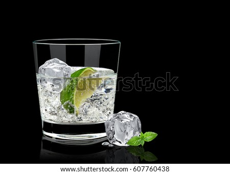 Gin tonic or vodka lime and basil isolated on black background #607760438