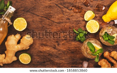 Ginger Ale Cocktail with Beer, Lime, Lemon and Mint in glaass on wooden table, top view  Stockfoto ©