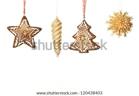 ginger and wood Christmas decoration on white background