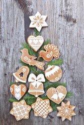 Ginger bread with christmas tree on wooden background