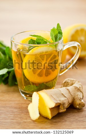 ginger in a cup of tea with lemon and mint