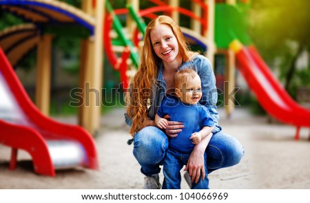 Ginger mother with baby