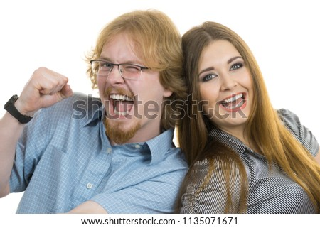 Ginger nerdy man and beautiful teen woman having fun together posing for picture.