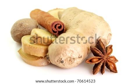 Ginger, nutmeg, cinnamon, anise on a white background
