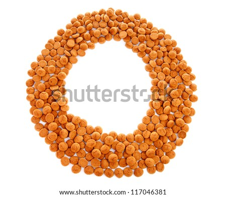 Ginger nuts, pepernoten, in the shape of round and letter 0 isolated on white background. Typical Dutch candy for Sinterklaas event in december
