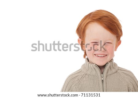 Ginger red hair haired boy funny face laughing isolated on white