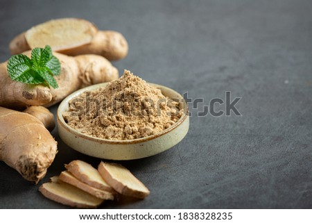 Ginger root and ginger powder on table Photo stock ©