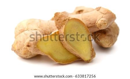 Ginger root sliced isolated over white background