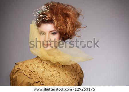 ginger woman in retro concept looking at camera